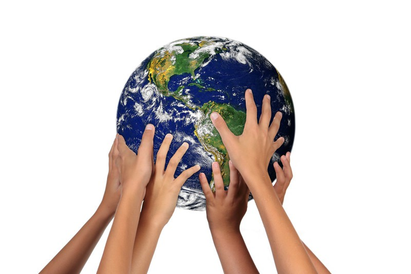 Hands holding model of earth