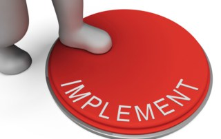 "stepping on the ""implement"" button"