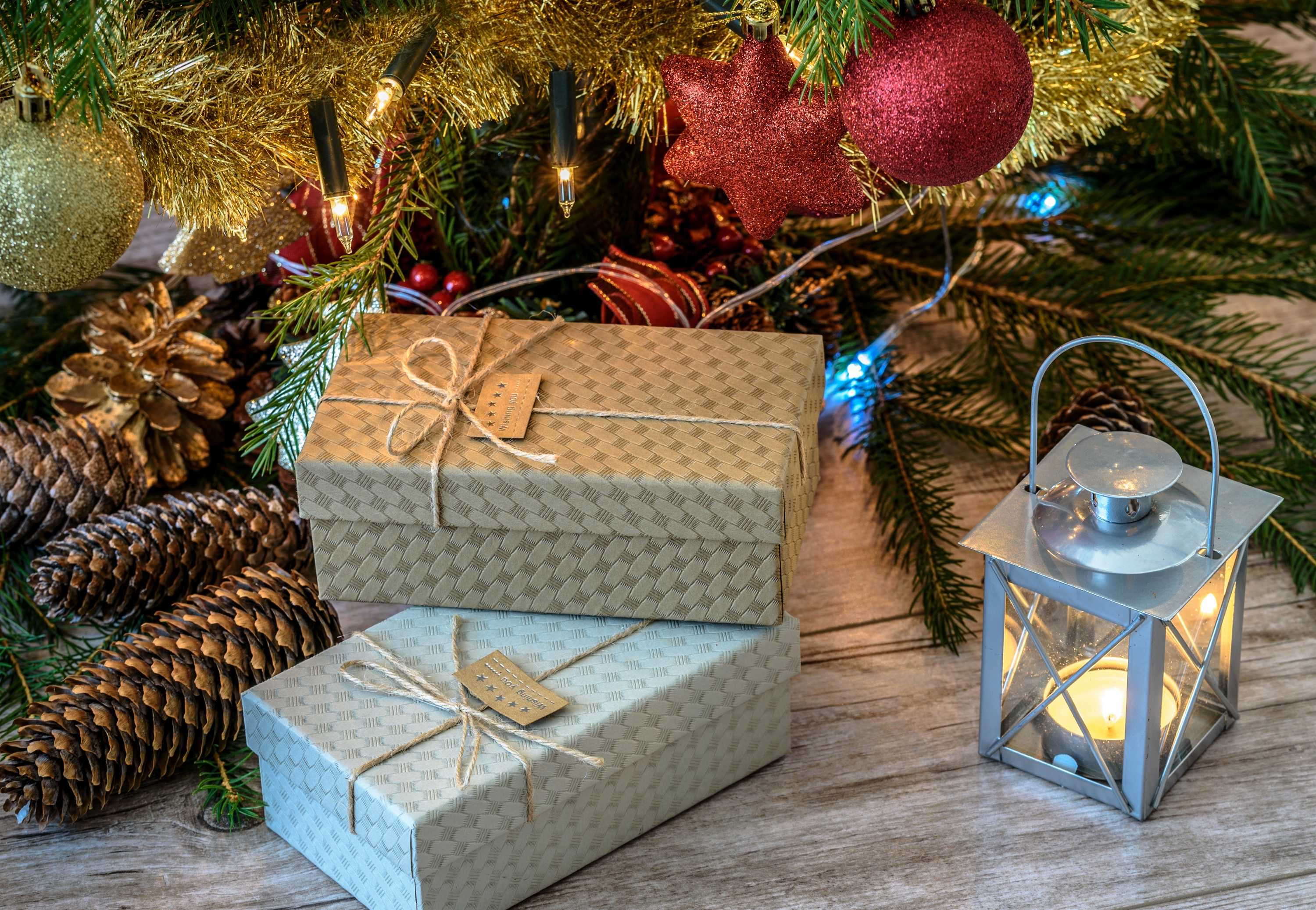 wrapped gifts by tree