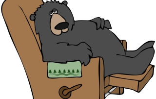 Bear relaxing in lounge chair
