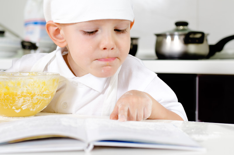 Little boy checking ingredients