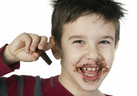 young boy with chocolate on face